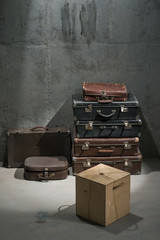 Old suitcases are stacked on the floor