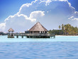 Lodges over transparent quiet sea water- tropical paradise,