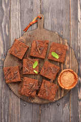 chocolate brownies on vintage cutting board