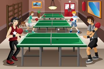Teenagers playing ping pong