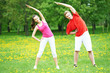 Fitness man and woman doing stretching exercises