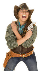 cowgirl with gun and holster laugh