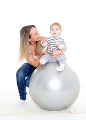 Happy family with fitness ball.