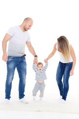 Parents with baby. First steps.