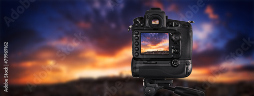 canvas print picture Dslr camera shooting on a cityscape sunset