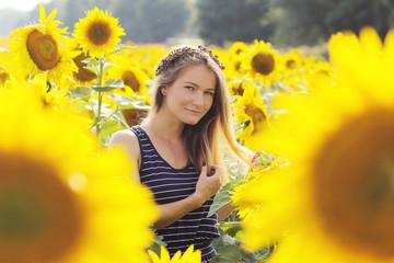 girl among sunflowers field