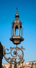 Vintage wrought-iron lantern decorating Bridge in Prague
