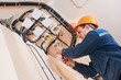 electrician works with electric network - 79970175