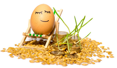funny egg and Stack of coins and rice seeds
