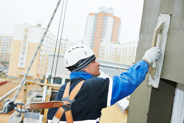 worker at plastering facade work