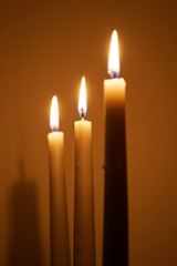 Three candles in the dark room