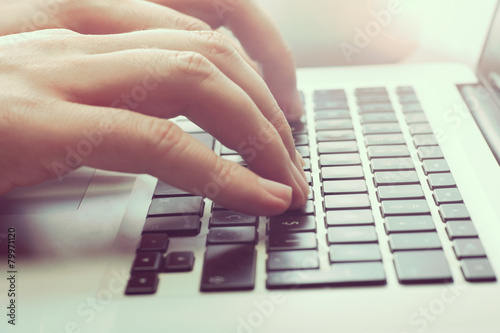 Man Typing - 79971120