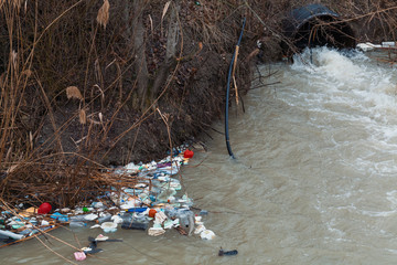 environment pollution concept. garbage over the stream.
