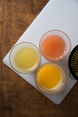 Glasses of fresh fruit juices from above