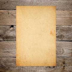 Vintage paper on old wooden background