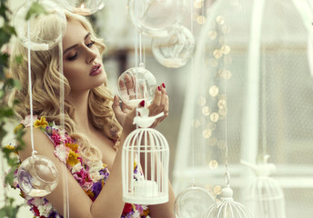 Glamour portrait of blond woman with baubles
