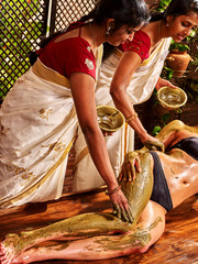 Woman having Ayurvedic body  spa massage.