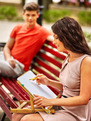 Couple  at park on bench.