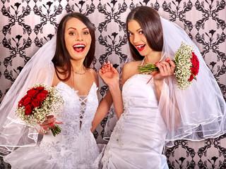 Wedding lesbians girl in bridal dress.
