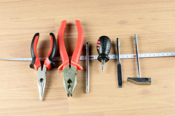 Pliers, screwdriver, hammer and measuring tape