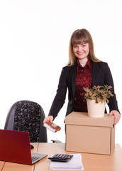 Adopted at work in office girl puts things out of box