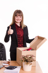 The girl behind the office desk with a box showing thumb