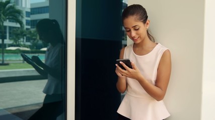 Happy Business Woman Typing With Pen On Smartphone