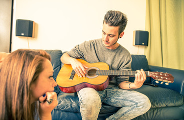 Couple sing and play guitar