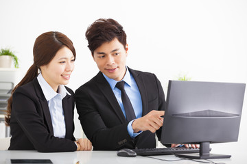 Business people Having Meeting and looking the computer