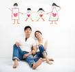 happy Young Couple looking the family concept draw