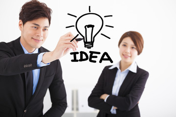 Businessman drawing bulb and idea business  concept