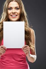 smiling model holding blank white advertising board.