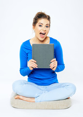 Happy woman holding book . Smiling girl sitting pose isolated o