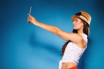 girl using tablet taking picture of herself