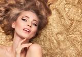 Fashion Beauty Girl Lying On Golden Glitter. - 79980591