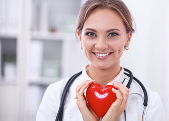 Doctor with stethoscope holding heart, isolated on white