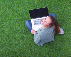 young woman on the grass in park or garden