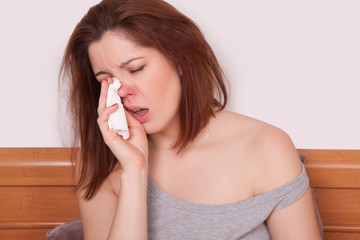 Sick Woman Caught Cold. Sneezing into Tissue. Headache