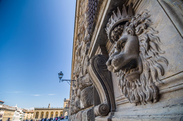Lion head relief on the facade of Pitti Palace, Florence, Italy