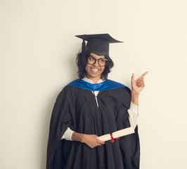 indian female student graduating in vintage tone