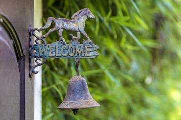 Metal sign welcome.