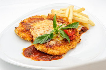 Chicken fillet with french fries and sauce