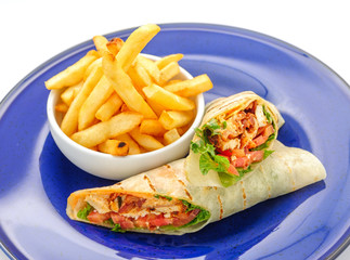 Burritos with french fries on blue plate