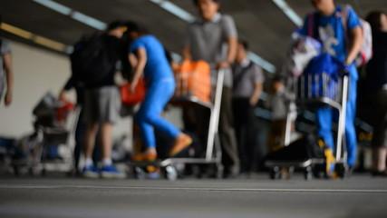 Airport travelers defocused