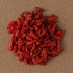 Circle of dry red goji berries
