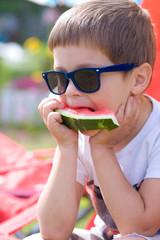 boy eating watermelon