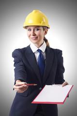 Businesswoman with helmet on white