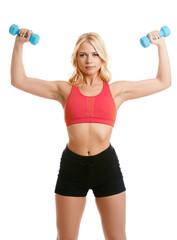 Lovely blonde exercising with dumbbells