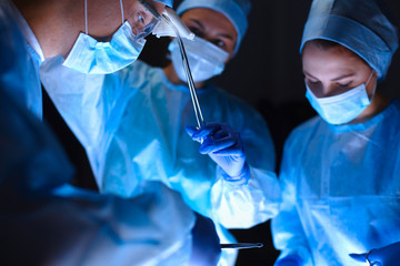 Team surgeon at work in operating