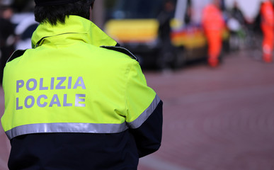 Italian policeman of local police check the city